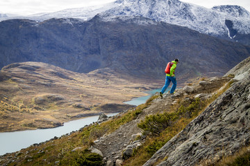 Man speed hiking along mountain trail, Norway, Europe