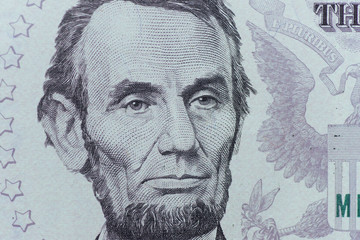 US President Abraham Lincoln face on five dollar bill macro, 5 u