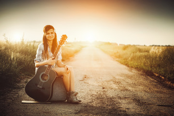 Traveler hippie girl with guitar