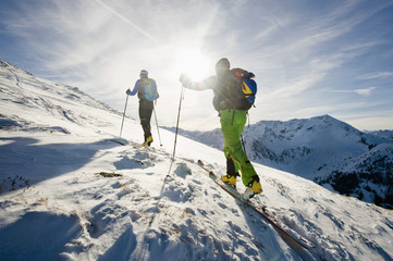 Backcountry skiers on the move, with back light, Alpbachtal, Tyrol, Austria, Europe