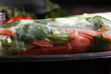 Vietnamese Salad spring roll, summer roll with vegetables, lettuce and rice noodles