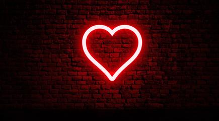 Neon heart on brick wall