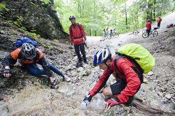 Mountain Bikers By River, Schwangau-Bleckenau, Bavaria, Germany