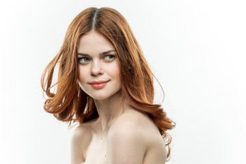 cute red-haired woman on a light background