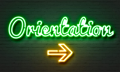 Orientation neon sign on brick wall background. Wall mural