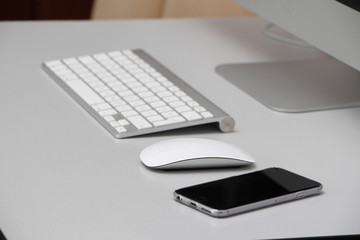 iphone, mouse, keyboard and imac desktop computer on the desk