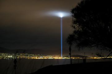 Nighttime view on Hobart, Tasmania from eastern shore shows a strobe of light during 2013 Dark Mofo Art festival