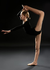 Photo Blinds Gymnastics Young girl doing gymnastic exercise on dark background