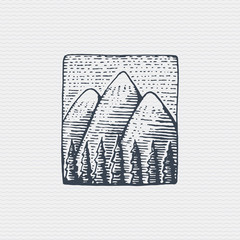 vintage old logo or badge, label engraved and old hand drawn style with mountains peak above forest