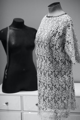 two mannequins one in lacy dress, another without cloth - monochrome photo