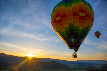 Fotobehang Ballon Hot Air Balloon Over Vineyards At Sunrise Over Napa Valley, Napa, California USA
