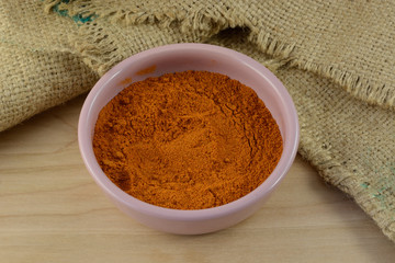 Bowl of ground red pepper spice in bowl