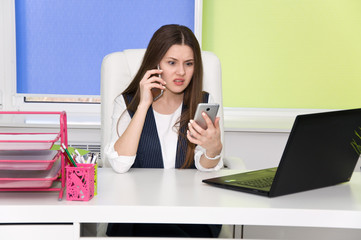 employee in the office is constantly a lot of talking on the phone