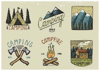 set of engraved vintage, hand drawn, old, labels or badges for camping, hiking, hunting with tent, axe and campfire with mountains