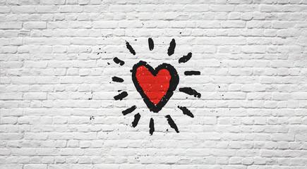 Foto auf AluDibond Graffiti Coeur sur mur de briques