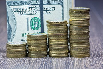 a lot of coins and dollars banknotes