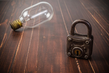 Old retro padlock and light bulb