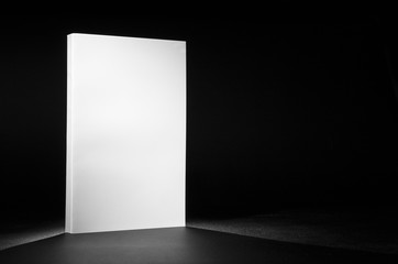 Real white book on a black background