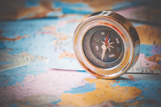 compass on map background travel. pointer. selective focus.
