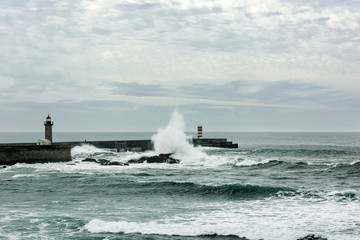 stormy sea waves over lighthouse in Porto, Portugal