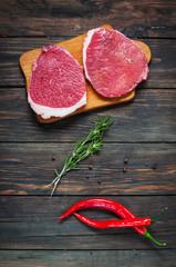Printed kitchen splashbacks Meat Fresh raw beef steak and chilli pepper on wood