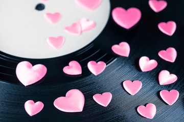 Love Song Record / Detail of vintage record with white blank label and many pink decorative hearts