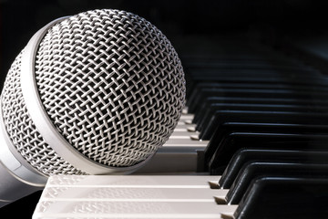 Microphone on piano keyboard, closeup