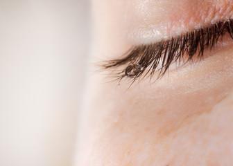 A tear on eyelashes closeup