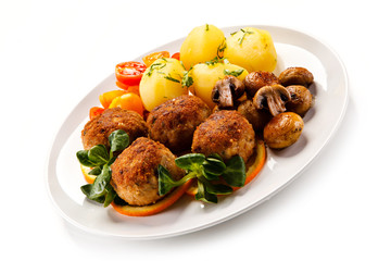 Roast meatballs and vegetables