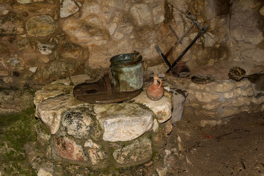 The Old bucket and the clay jug on the water well in Nazareth Village, Israel.