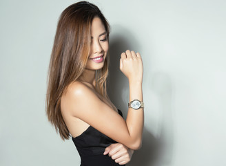 beautiful asian woman with wrist watch