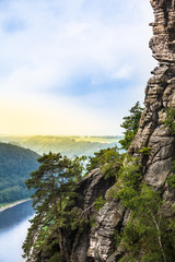 Mountain River Valley / Rock of sandstone at Saxon Switzerland and view to Elbe river, sunny hills at the horizon (copy space)