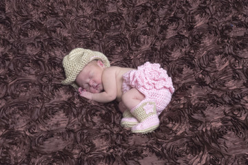 newborn girl in cowgirl outfit