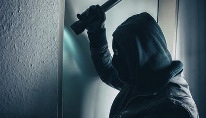 Thief opening a door at night