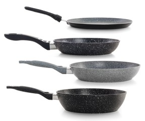 Set of black frying pans isolated on white background