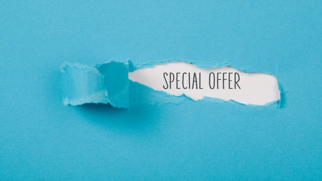 Special Offer message on Paper torn ripped opening