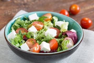 Salast with cherry tomatoes, Radicchio lettuce, frize, arugula and feta