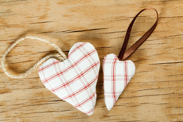 Heart from cloth on wood desk