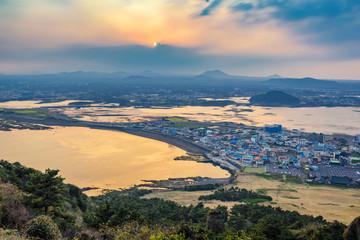 Jeju city skyline when sunset view from Seongsan Ilchulbong, Jeju Island, South Korea