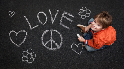 Cute Boy, with Chalk on Street/Tarmac, Love Peace Flowers Happiness