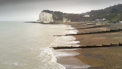 Aerial view of a beach in Dover with the White Cliffs in the background