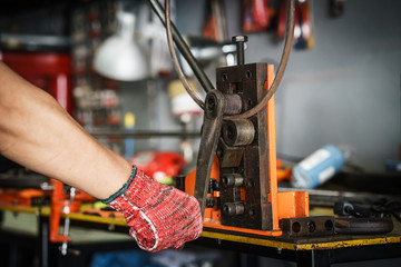 workers hands using with bending machine rebar for building equipment . selective focus
