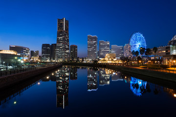 Cityscape of Minato Mirai area of Yokohama City at dusk (横浜みなとみらい地区夕景) in Kanagawa, Japan.