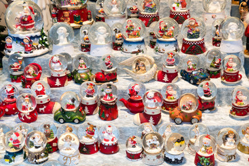 Christmas stall with snow balls and several puppets