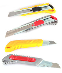 colorful utility knives (box cutter) on white background