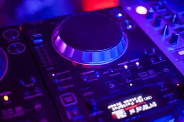 DJ Mixes and Play at Disco Party