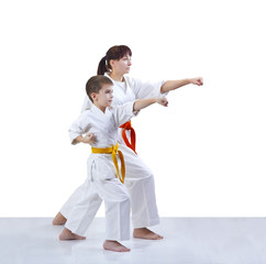 With yellow and orange belt the mother and son are hitting a punch arm