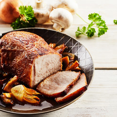 Succulent veal roast with onion and mushrooms