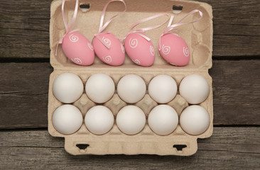 Carton of organic eggs on wooden background. Top view.