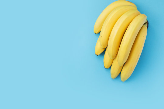 Banana bunch on blue background